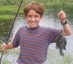 My son Caleb with his first crappie
