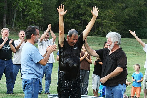 Paul Pavao baptizing Roy Pavao